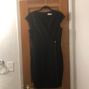 Black Calvin Klein sheath dress.